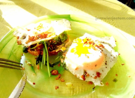 Easy breakfast: multi grain bagels with spinach sauteed with green onions, runny eggs and bacon...
